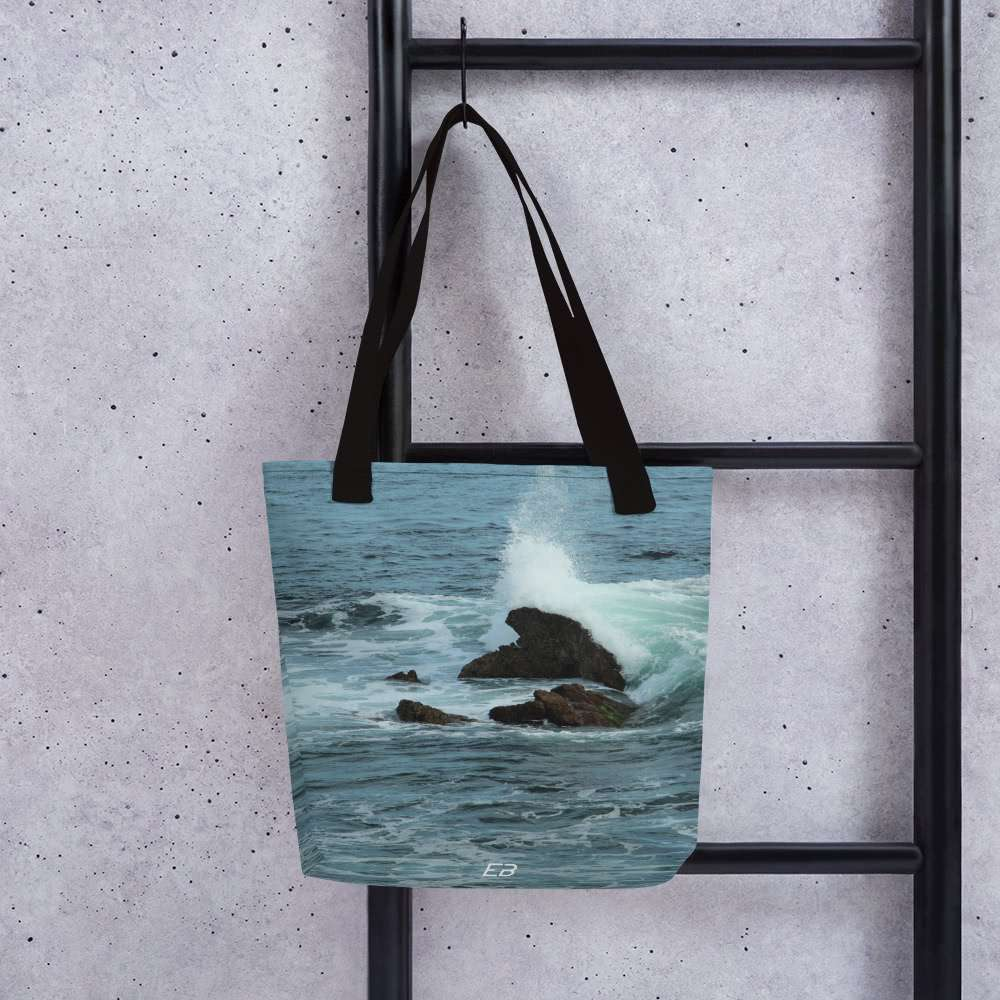 The Laguna Beach Breakers Tote Bag hanging from a ladder.
