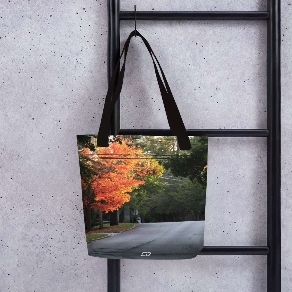 The Road To Autumn Tote Bag hanging from a ladder.